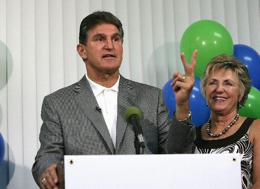 "Associated Press photographs West Virginia Gov. Joe Manchin III (left), a Democrat, leads in polls for a Senate seat, but his GOP rival, businessman John Raese (right), has closed the gap. One analyst calls it a ""race worth watching."""
