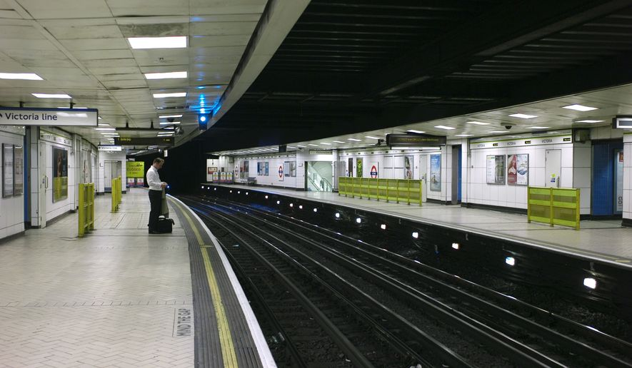 A commuter waits on a empty platform at the closed Victoria underground station in London, Tuesday, Sept. 7, 2010. Millions of Londoners are struggling to get to work by road, rail boat and bicycle as a strike by London Underground workers shuts down much of the city's subway system. (AP Photo/Sang Tan)