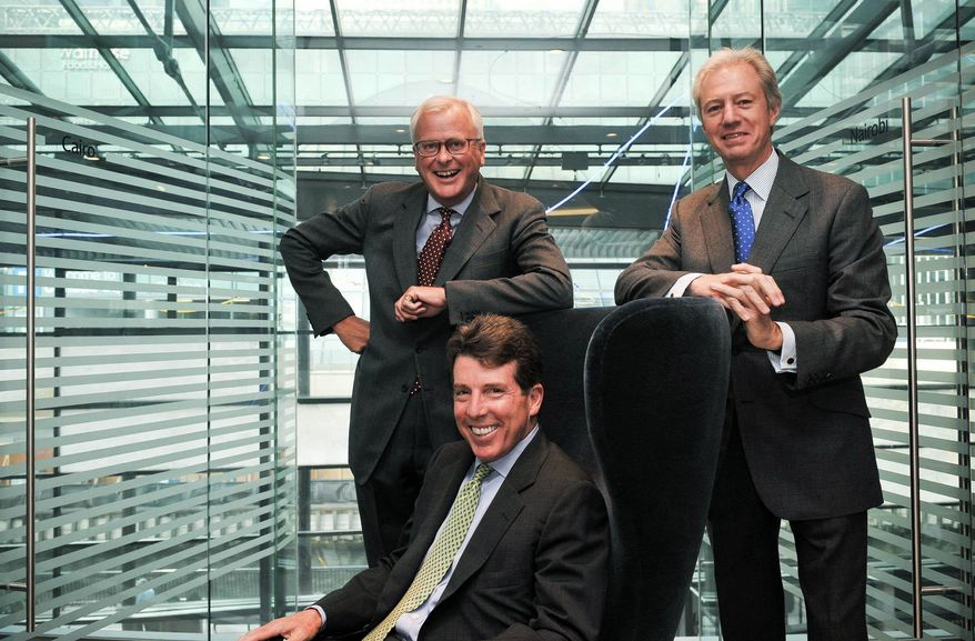 In this photo released by VisMedia, the newly announced Barclays PLC Chief Executive Robert E. Diamond Jr., center, poses for a photograph with outgoing Barclays CEO John Varley, left, and Barclays chairman Marcus Agius, right, at Barclays headquarters in Canary Wharf, London, Tuesday, Sept. 7, 2010. Mr. Diamond, who built Barclays PLC into a global powerhouse in investment banking and has been criticized for his lavish pay, will become chief executive next year, the company announced Tuesday. (AP Photo/VisMedia, Daniel Lewis)