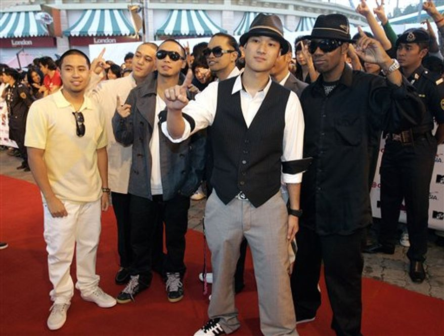 FILE - In this Aug. 2, 2008 file photo, dance group Jabbawockeez arrive on the red carpet at the MTV Asia Awards 2008 in Genting Highlands, outside Kuala Lumpur, Malaysia. (AP Photo/Lai Seng Sin, file)