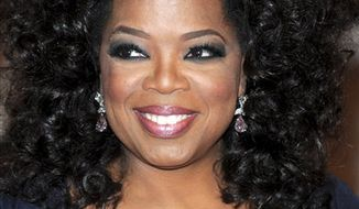 Oprah Winfrey is interviewed on the red carpet at the Kennedy Center Honors, in Washington, on Sunday, Dec. 5, 2010. The 2010 honorees are Merle Haggard, Jerry Herman, Bill T. Jones, Paul McCartney, and Winfrey. (AP Photo/Jacquelyn Martin)