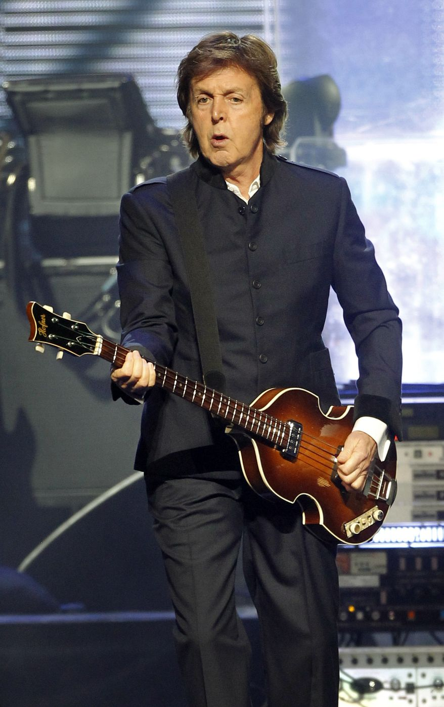 In this Aug. 18, 2010, file photo. Paul McCartney performs at the new CONSOL Energy Center in Pittsburgh. (AP Photo/Keith Srakocic, File)