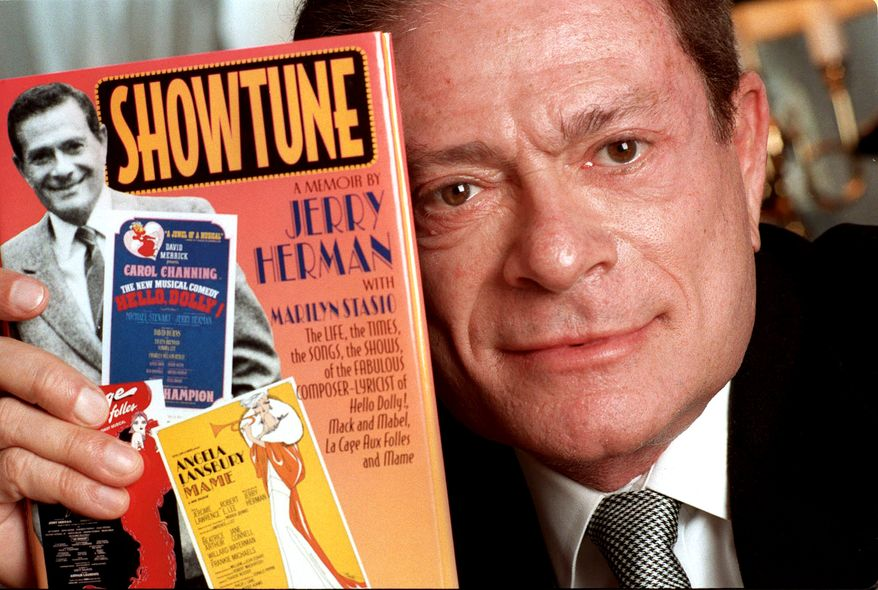 "In this Nov. 19, 1996, file photo, composer Jerry Herman displays his book ""Showtune,"" in New York. (AP Photo/Jim Cooper, File)"