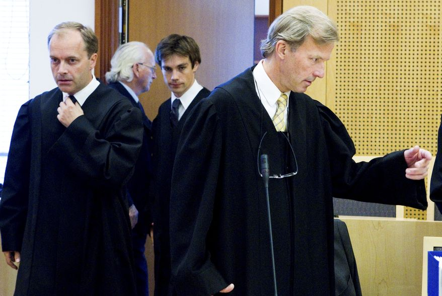 Defense lawyer Frode Sulland (right) and prosecutor Jan Glent (left) appear in court in Oslo on Tuesday, Sept. 7, 2010, before the start of the trial of a Somali-born Norwegian citizen charged with sending more than $30,000 to top leaders of an al-Qaeda-linked Somali militant group. (AP Photo/Scanpix, Berit Roald)