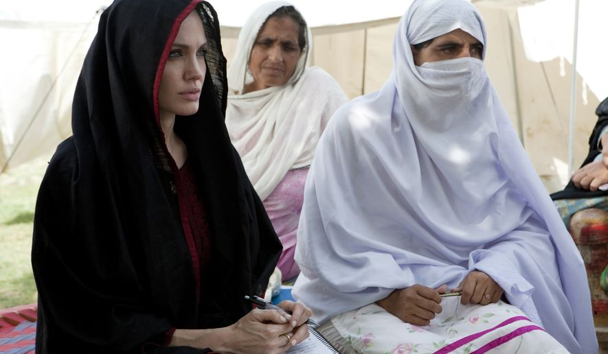 ** FILE ** In this photo provided by the United Nations High Commission for Refugees, Angelina Jolie, left, the goodwill ambassador of UNHCR, sits with Pakistani flood-affected women during her visit to a camp for people displaced by heavy floods in Nowshera, Pakistan, Tuesday, Sept. 7, 2010. (AP Photo/United Nations High Commission for Refugees, J. Tanner)