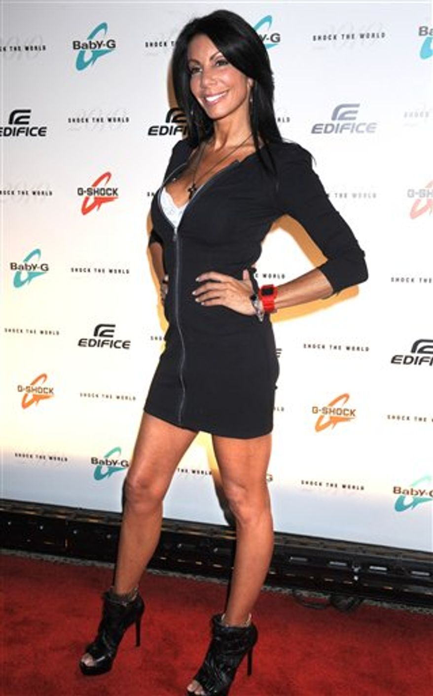 "FILE - In an Aug. 2, 2010 file photo ""Real Housewives of New Jersey"" star Danielle Staub arrives for the ""Casio Shock the World 2010"" event in New York. The Bravo network announced Monday, Sept. 6, 2010 that Staub would not be returning to the show. ( AP Photo/ Louis Lanzano/file)"