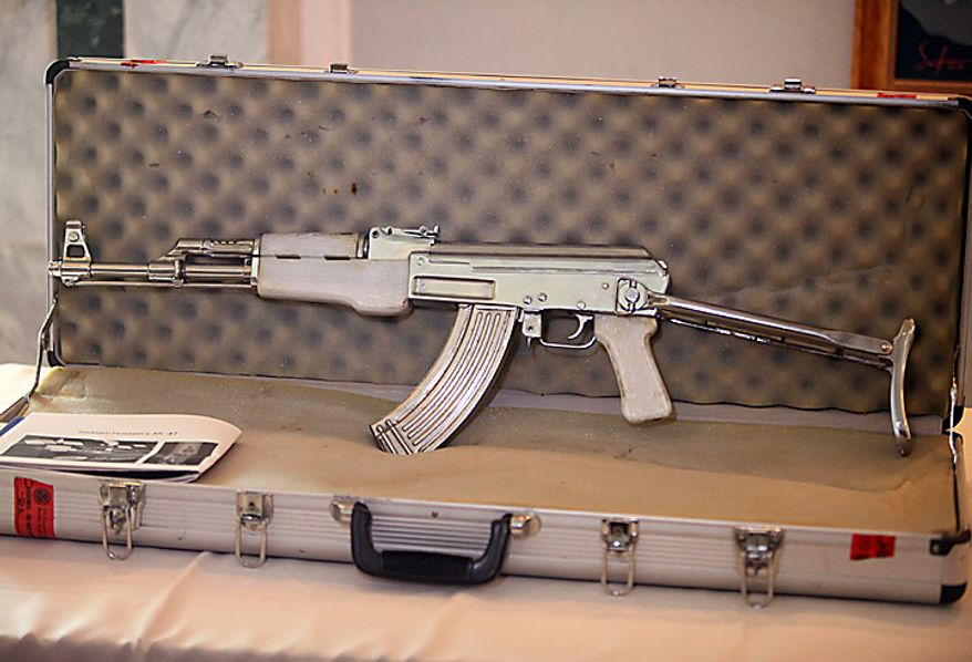 An AK-47, with Saddam Hussein's image on it, is displayed at the Iraqi Ministry of foreign Affairs in Baghdad, Iraq, Tuesday, Sept. 7, 2010. Hundreds of Iraqi artifacts looted from museums and archaeological sites across the country have been returned to Iraq. The display is part of Iraqi efforts to repatriate its looted cultural heritage. (AP Photo/Karim Kadim)