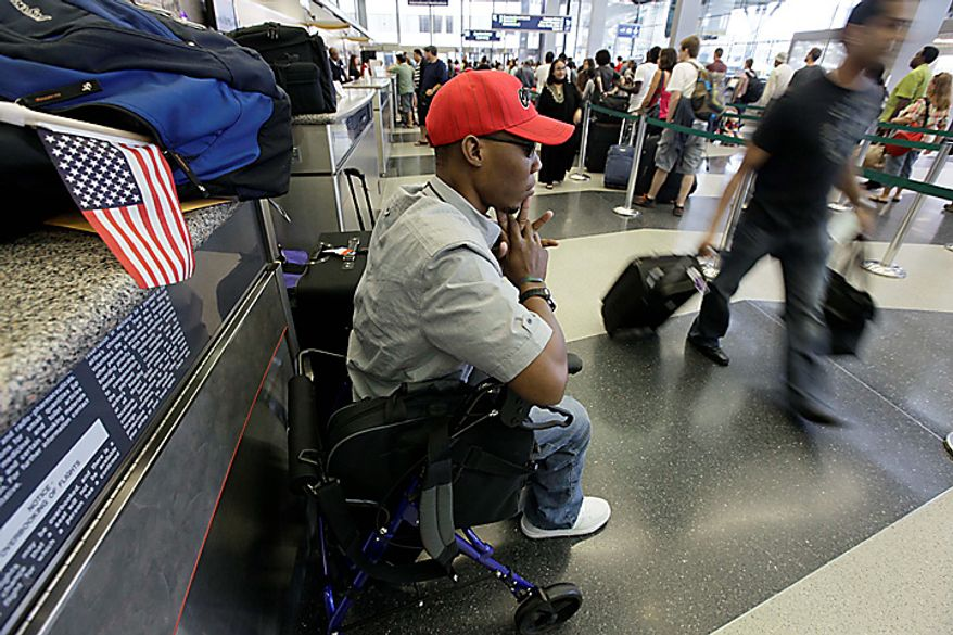 In this photo taken July 5, 2010, in Chicago, Bazelais Suy waits for his flight at O'Hare International Airport to return to his native Haiti. Suy is a Haitian student activist whose spine was crushed when a university building collapsed in Haiti's catastrophic earthquake last January. He was airlifted to Chicago for six months of intensive rehabilitation and recently returned to Haiti with hopes of helping rebuild the country. (AP Photo/M. Spencer Green)