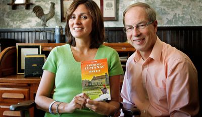 Farmers' Almanac Managing Editor Sandi Duncan and Editor Peter Geiger show off the 2011 edition in Lewiston, Maine. It and the Old Farmer's Almanac foresee a colder-than-normal winter.