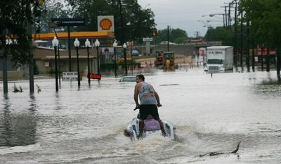 Associated Press Greg Moore, a local business owner, rides a recreational water vehicle down a flooded street in Belton, Texas, on Wednesday, after Tropical Storm Hermine deluged the region.