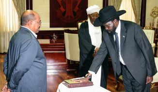 **FILE** Sudanese First Vice President Salva Kiir swears an oath in front of President Omar Bashir in Khartoum, Sudan, after an election marred by boycotts and fraud allegations in May. (Associated Press)