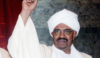 President Omar Bashir prepares to be sworn in at the parliament in Khartoum in May. Gen. Bashir is wanted by the International Criminal Court on charges of war crimes, crimes against humanity and genocide for his government's role in the war in Darfur. (Associated Press)