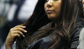 "Nicole Polizzi, better known as ""Snooki"" from the MTV show ""Jersey Shore"" sits in court Wednesday, Sept. 8, 2010, in Seaside Heights, N.J., waiting to face charges of being a public nuisance and annoying others on the Seaside Heights beach in July.  (AP Photo/Mel Evans)"