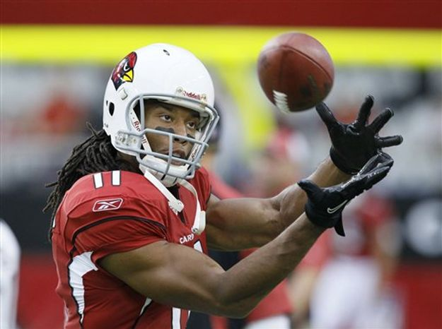 FILE - This Aug. 14, 2010, file photo shows Arizona Cardinals wide receiver Larry Fitzgerald warming up before playing an NFL preseason football game against the Houston Texans, in Glendale, Ariz.  Fitzgerald, sidelined with a knee injury most of the pre-season, expects to be back in the lineup when the Cardinals open their regular season Sunday in St. Louis.(AP Photo/Rick Scuteri, File)