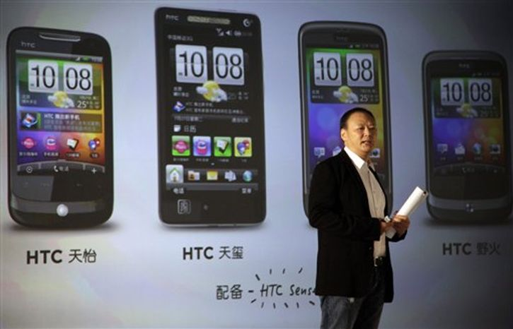 FILE - In this July 27, 2010 file photo, Peter Chou, chief executive officer of Taiwan's High Tech Computer Corp., or HTC Corp., talks about the introduction of the brand into China's market during a press conference held in Beijing, China. East Asia is the world's electronics factory, yet unless they are Japanese, producers are anonymous. Now HTC Corp., the Taiwanese maker of smart phones, is moving out of the shadows and trying to establish its own brand name as it competes with Apple's iPhone. (AP Photo/Ng Han Guan, File)