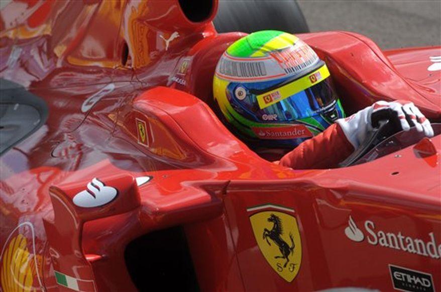 Formula One driver Felipe Massa of Brazil prepares to drive his 2009 Ferrari during a show at the Hungaroring circuit in Mogyorod, northeast of Budapest, Hungary, Sunday, Sept. 5, 2010. (AP Photo/MTI, Imre Foeldi)