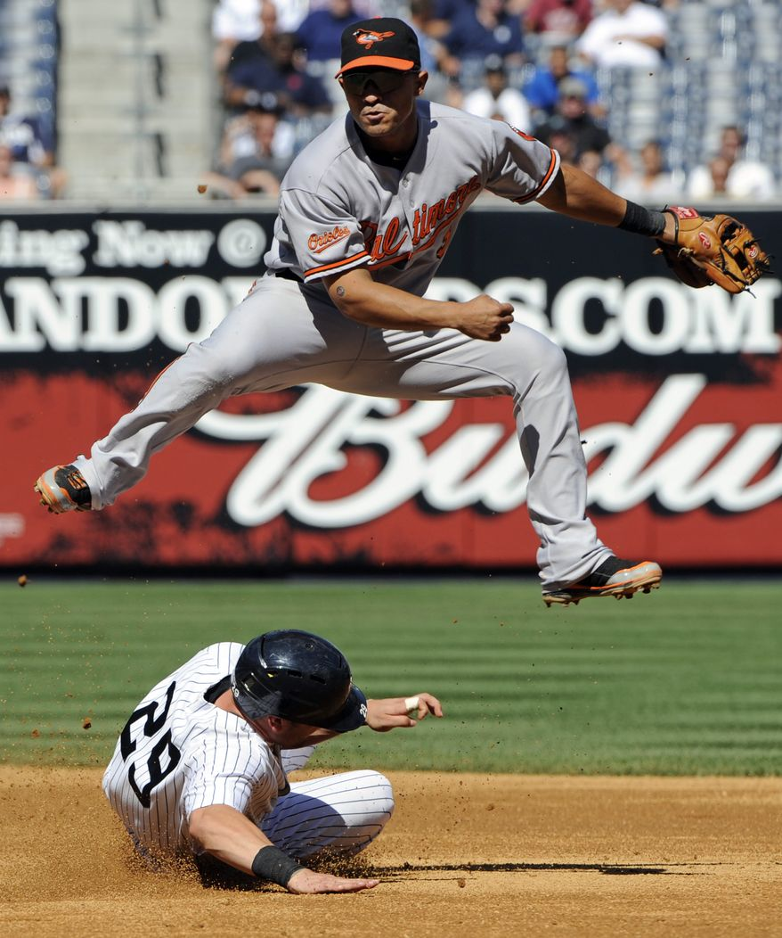 ASSOCIATED PRESS New York Yankees' Francisco Cervelli (29) is out at second as Baltimore Orioles shortstop Cesar Izturis relays the ball to first to complete the double play on Brett Gardner during the fifth inning of a baseball game Wednesday, Sept. 8, 2010, at Yankee Stadium in New York.