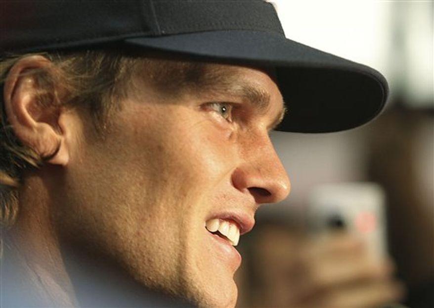 New England Patriots quarterback Tom Brady talks during a media availability at the NFL football team's facility in Foxborough, Mass., Wednesday morning, Sept. 8, 2010. (AP Photo/Stephan Savoia)