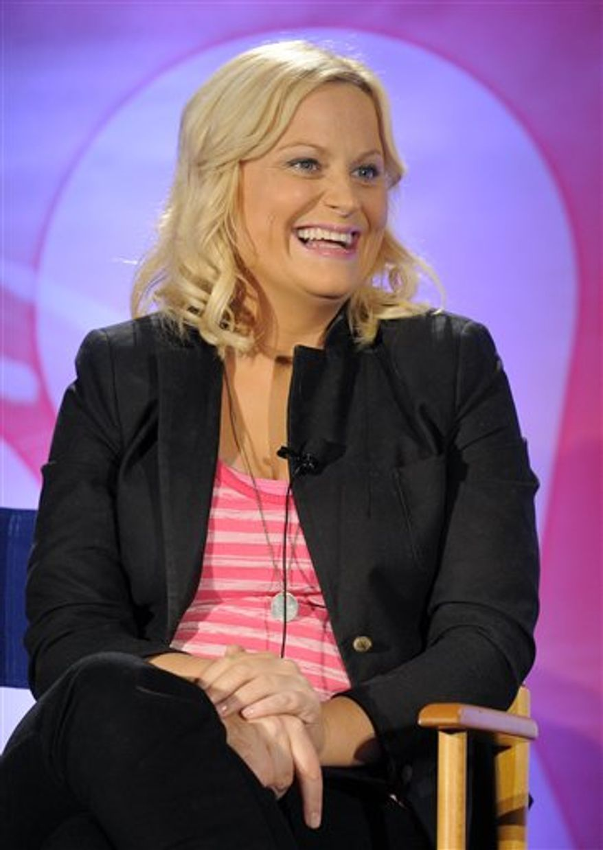 "FILE - In this April 26, 2010 file photo, Amy Poehler answers a question during the NBC Universal 2010 Summer Press Day in Pasadena, Calif. NBC says ""Saturday Night Live"" will launch its 36th season on Sept. 25, 2010 with host Amy Poehler and musical guest Katy Perry. Poehler is a former ""SNL"" cast member and will return to make her hosting debut. (AP Photo/Chris Pizzello, File)"