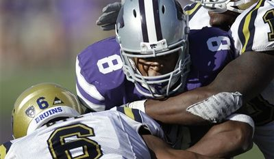 Kansas State running back Daniel Thomas (8) is tackled by UCLA safety Tony Dye (6) and linebacker Akeem Ayers (10) and defensive back Ryan Sublett (10) during the second half of an NCAA college football game Saturday, Sept. 4, 2010, in Manhattan, Kan. Thomas rushed for 235 yards to lead Kansas State to a 33-21 win over UCLA. (AP Photo/Orlin Wagner)
