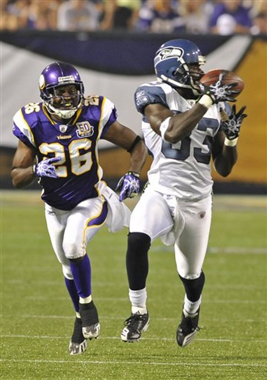 In this Aug. 28, 2010, file photo, Seattle Seahawks wide receiver Deion Branch, right, pulls in a pass as Minnesota Vikings cornerback Antoine Winfield (26) pursues during an NFL preseason football game in Minneapolis. Vterans Winfield and Lito Sheppard and second-year pro Asher Allen are the only three healthy cornerbacks heading into the Vikings' game against a New Orleans Saints offense that loves to run four, and sometimes even five, receivers on any given play. (AP Photo/Jim Mone, File)