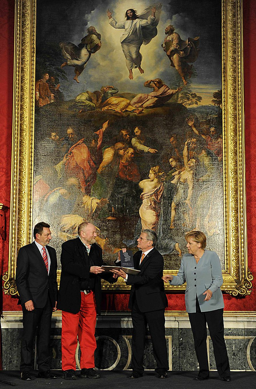 Danish cartoonist Kurt Westergaard, second left, is congratulated on his prize by German Chancellor Angela Merkel, right, and the former head of the state-funded body which manages the archives of the former East German secret police Stasi Joachim Gauck, second right, as Potsdam's mayor Jann Jakobs looks on after receiving the M100 Media Prize 2010 in Potsdam near Berlin, eastern Germany, Wednesday, Sept. 8, 2010. Westergaard drew the most controversial of 12 caricatures of the Prophet Mohammed, first published in a Danish newspaper in 2005, which many Muslims considered offensive. (AP Photo/Odd Andersen, pool)