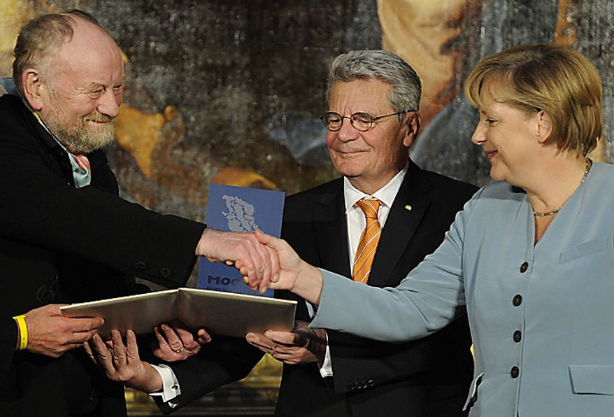 Danish cartoonist Kurt Westergaard, left, is congratulated on his prize by German Chancellor Angela Merkel, right, and the former head of the state-funded body which manages the archives of the former East German secret police Stasi Joachim Gauck, center, after receiving the M100 Media Prize 2010 in Potsdam near Berlin, eastern Germany, Wednesday, Sept. 8, 2010. Westergaard drew the most controversial of 12 caricatures of the Prophet Mohammed, first published in a Danish newspaper in 2005, which many Muslims considered offensive. (AP Photo/Odd Andersen, pool)