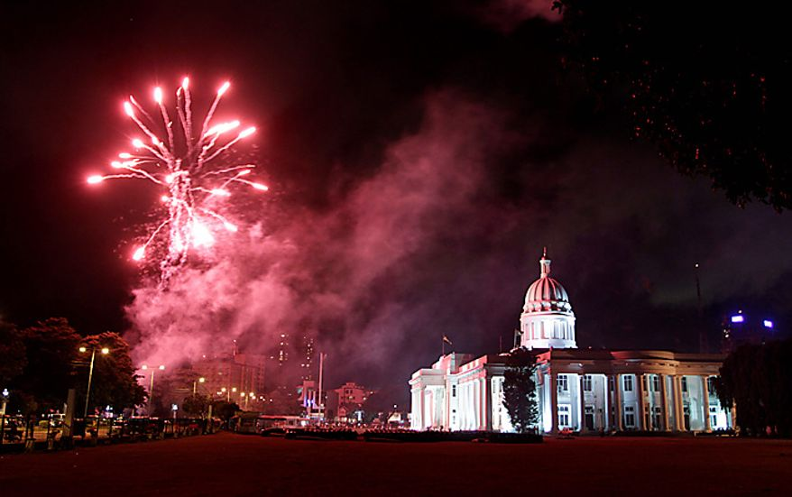 Fireworks light up the sky near the Municipal Council building as the government celebrates the passage of the constitutional amendment in Colombo, Sri Lanka, Wednesday, Sept. 8, 2010. Sri Lanka's Parliament voted to eliminate term limits for the president Wednesday, a move critics say could lead to dictatorship. (AP Photo/ Eranga Jayawardena)
