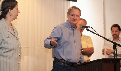 ASSOCIATED PRESS Sen. Michael D. Crapo, Idaho Republican, addresses a group of brewers, farmers and concerned citizens in his state about a tax relief bill for small breweries. Mr. Crapo is a Mormon but says he won't impose his religious beliefs on others.