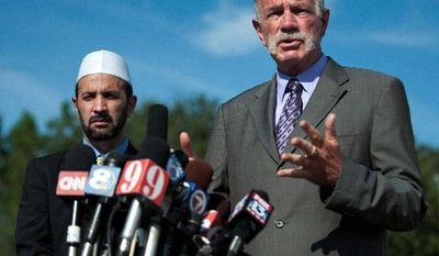 credit three lines three lines three lines three lines three lines three lines three lines three lines three lines three lines three lines three lines three lines three lines three lines three lines three lines three lines.   Pastor Terry Jones of the Dove World Outreach Center speaks to the media as Imam Muhammad Musri of the Islamic Society of Central Florida looks on at left, Thursday, Sept. 9, 2010, in Gainesville, Fla. (AP Photo/Phil Sandlin)