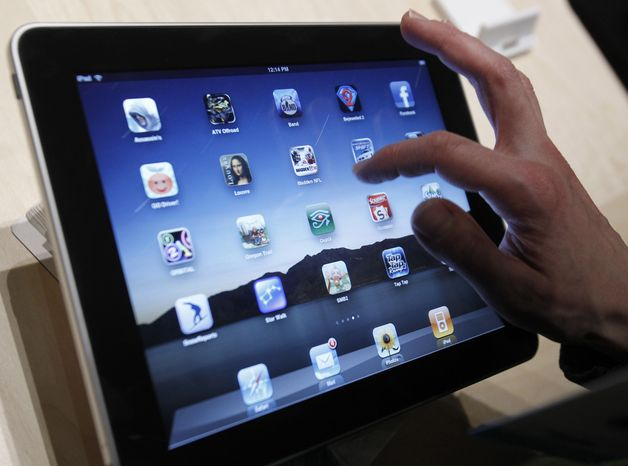 In this Jan. 27, 2010, file photo, the iPad is shown after it was unveiled at the Moscone Center in San Francisco. Apple Inc. said Thursday, Sept. 9, 2010, that it will publish the guidelines it uses to determine which programs can be sold in its App Store. (AP Photo/Marcio Jose Sanchez, FILE)