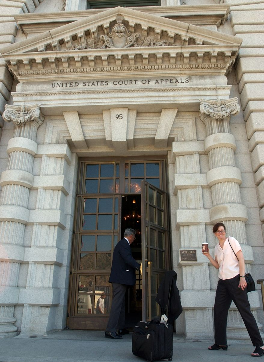 A woman waits to get into the 9th U.S. Circuit Court of Appeals building in San Francisco, in this Sept. 22, 2003 file photo. A sharply divided 9th U.S. Circuit Court of Appeals Wednesday, Sept. 8, 2010, threw out a lawsuit that challenged Boeing Co.'s role flying terrorism suspects to secret prisons and raised questions about the government's ability to quash lawsuits when state secrets are involved. (AP Photo/Paul Sakuma, File)
