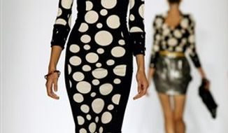 Fashion from the Project Runway Spring 2011 collection is modeled, Thursday Sept. 9, 2010, during Fashion Week in New York. (AP Photo/Bebeto Matthews)
