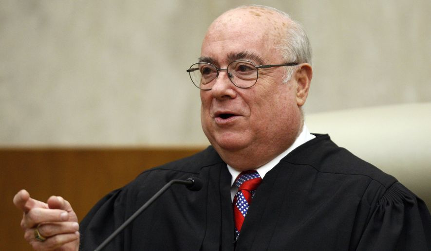 In this May 1, 2008, file photo, U.S. District Judge Judge Royce C. Lamberth is seen during a ceremony at the federal courthouse in Washington. Judge Lamberth on Monday, Aug. 23, 2010. (AP Photo/Charles Dharapak, File)