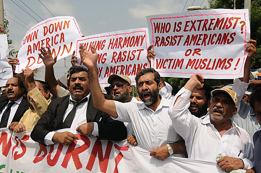 Pakistani protesters rally in reaction to a small American church's plan to burn copies of the Quran in Multan, Pakistan on Thursday, Sept. 9, 2010. (AP Photo/Khalid Tanveer)