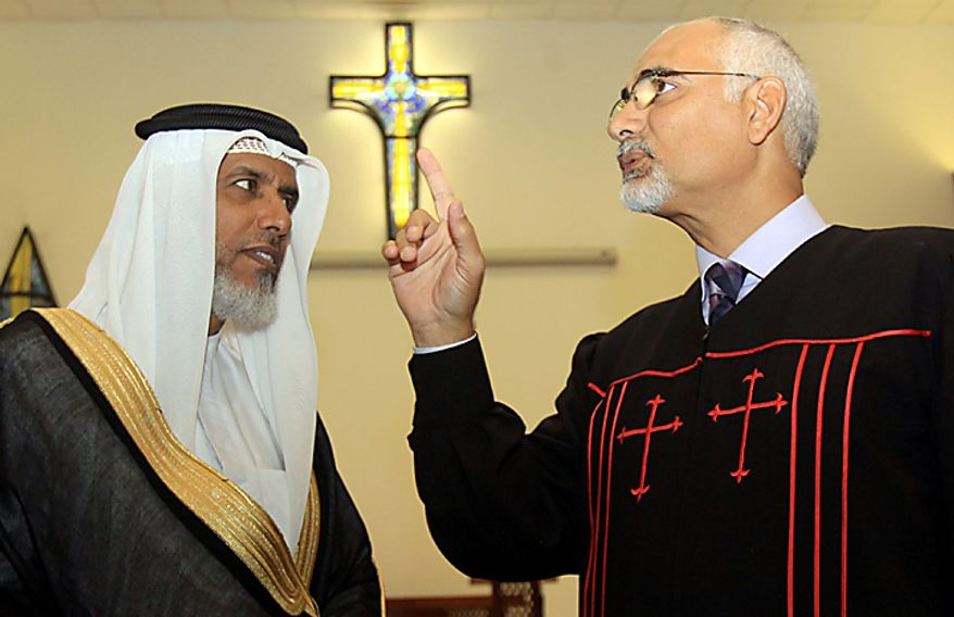 "The Rev. Hani Aziz, right, speaks of the one God of Muslim and Christian beliefs, during a statement Thursday, Sept. 9, 2010, to journalists delivered with Muslim cleric Sheikh Salah bin Yousuf al-Jowder, left, at the National Evangelical Church in Manama, Bahrain. The men denounced a Florida preacher's planned Sept. 11 Quran-burning, as a ""detestable act."" (AP Photo/Hasan Jamali)"