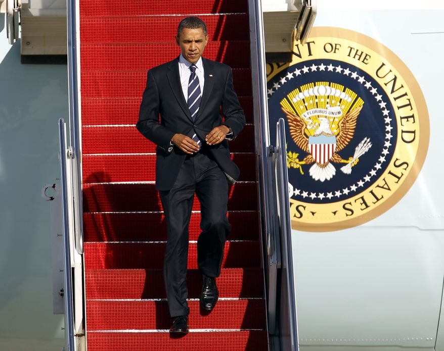 President Obama walks down the stairs from Air Force One upon his arrival at Andrews Air Force Base, Md., Wednesday, Sept. 8, 2010. (AP Photo/Jose Luis Magana)
