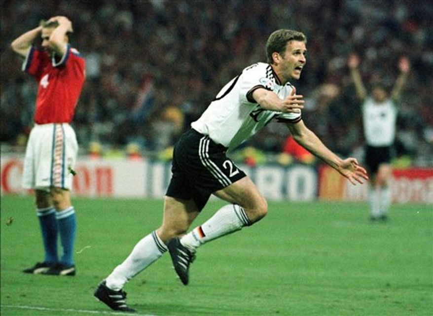 """FILE - In this June 30, 1996 file picture Oliver Bierhoff of Germany, celebrates after scoring the winning """"Golden Goal"""" during extra-time to secure the European Soccer Championship against the Czech Republic at Wembley Stadium in London. In 514 matches for club and country, German wunder-forward Oliver Bierhoff scored 226 times. Yet only once did he celebrate by whipping off his shirt: when he left-footed the golden goal that made Germany the European champion in  1996. That winner against the Czech Republic, after just four minutes of extra time, was the first ever golden goal scored in a major international competition. """"For sure the most important goal in my career,"""" Bierhoff says. (AP Photo/Santiago Lyon, File)"""
