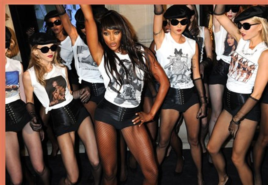 "Naomi Campbell performs with models to celebrate the 25th anniversary of her career in front of the Madison Avenue Dolce & Gabbana store, Friday, Sept. 10, 2010, in New York. 25th anniversary T-shirts will be available and will support the charity "" Fashion for Relief"" founded by Naomi. ( AP Photo/ Louis Lanzano)"