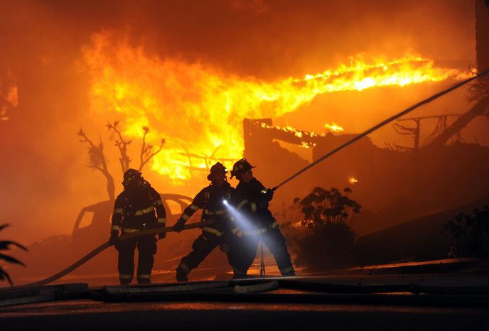 Firefighters battle a blaze possibly resulting from a high-pressure gas-line explosion in San Bruno, Calif., on Thursday, Sept. 9, 2010. (AP Photo/Bay Area News Group, Karl Mondon)