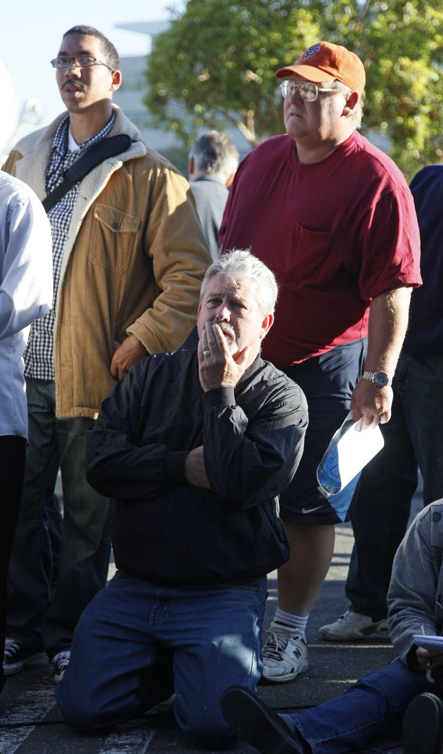 San Bruno, Calif., resident Lester Vaccari, bottom, listens to find out when he can return to his home following a massive gas explosion, during a press conference at a shopping center in San Bruno, Calif., Friday, Sept. 10, 2010. (AP Photo/Eric Risberg)