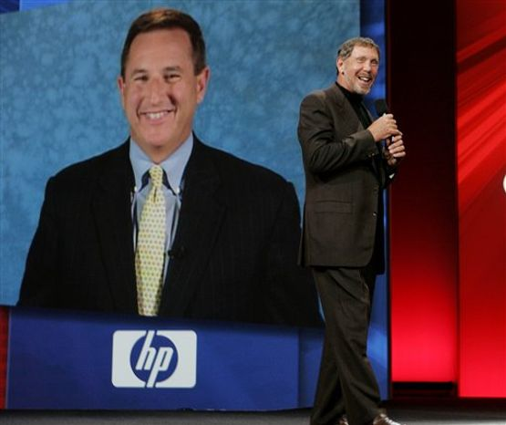 FILE - In this Sept, 24, 2008 file photo, Oracle CEO Larry Ellison, right, and (then) Hewlett Packard CEO Mark Hurd, on screen, smile during the Oracle Open World conference in San Francisco. As co-president at Oracle Corp., ousted Hewlett-Packard Co. CEO Mark Hurd will have to adapt to a new role playing second fiddle to one of Silicon Valley's most domineering bosses _ Larry Ellison. (AP Photo/Paul Sakuma, file)