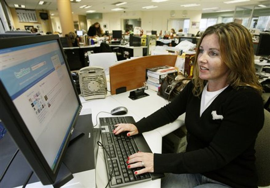 Associated Press movie critic Christy Lemire works on her Twitter page at her computer at the Associated Press bureau in Los Angeles on Wednesday, Sept. 8, 2010. (AP Photo/Nick Ut)