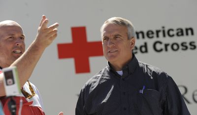 Jim Rettew of the Red Cross talks with Gov. Bill Ritter at the Red Cross emergency shelter at the Boulder YMCA on Friday Sept. 10, 2010. (AP Photo/Craig F. Walker - The Denver Post)