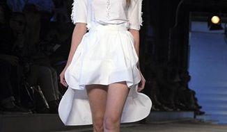 The Edun spring 2011 collection is shown during Fashion Week in New York, Saturday, Sept. 11, 2010. (AP Photo/Diane Bondareff)