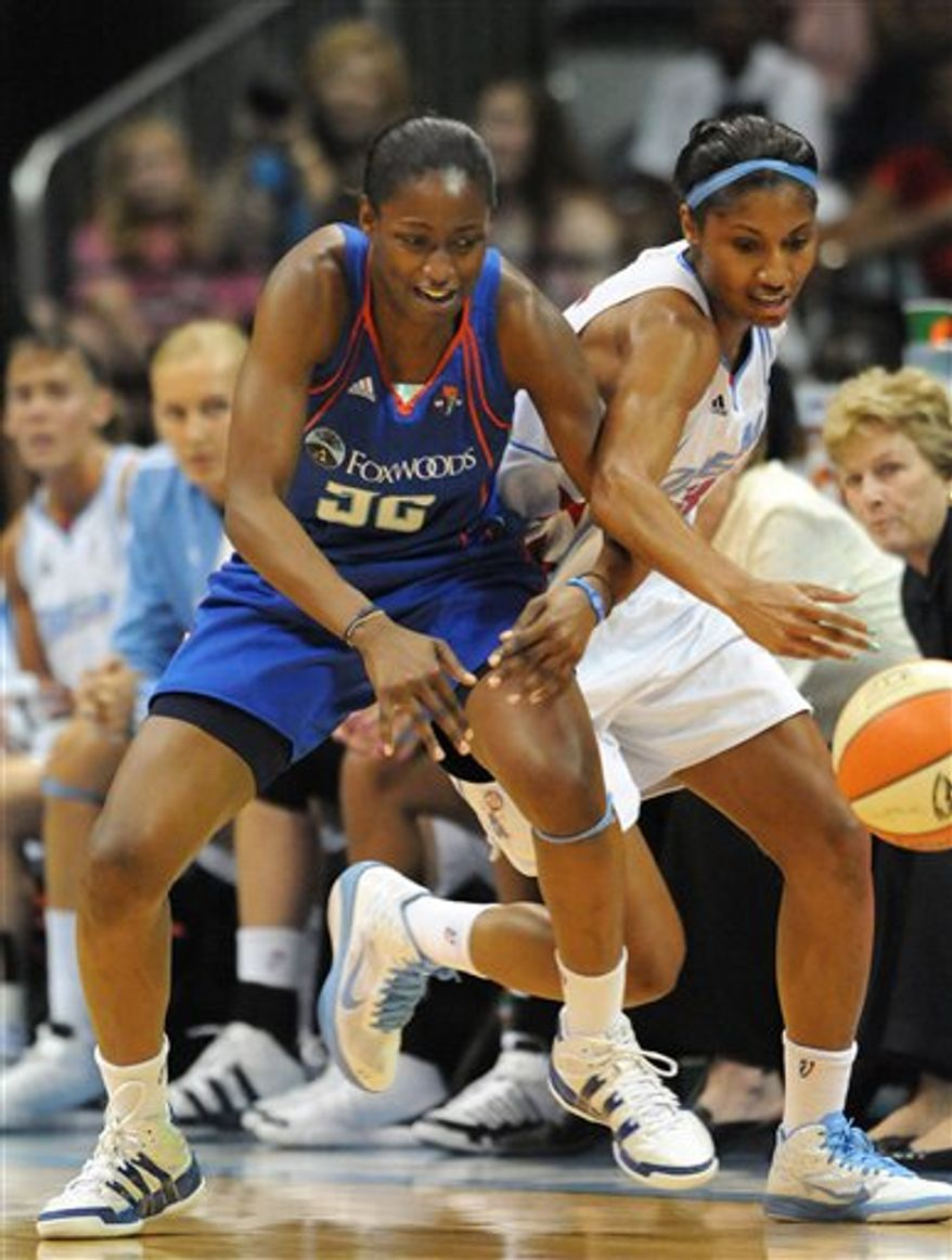Atlanta Dream forward Angel McCoughtry, right, steals the ball away from New York Liberty guard Kalana Greene during the first half of Game 2 of the WNBA basketball Eastern Conference finals Tuesday, Sept. 7, 2010, in Atlanta. (AP Photo/Erik S. Lesser)