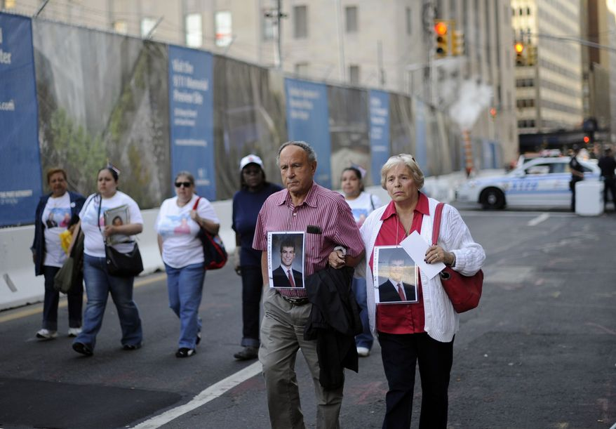 Victims' families walk toward New York City's September 11th Commemoration Ceremony site on Saturday, Sept. 11, 2010, on the ninth anniversary of the terrorist attacks. (AP Photo/Stephen Chernin)