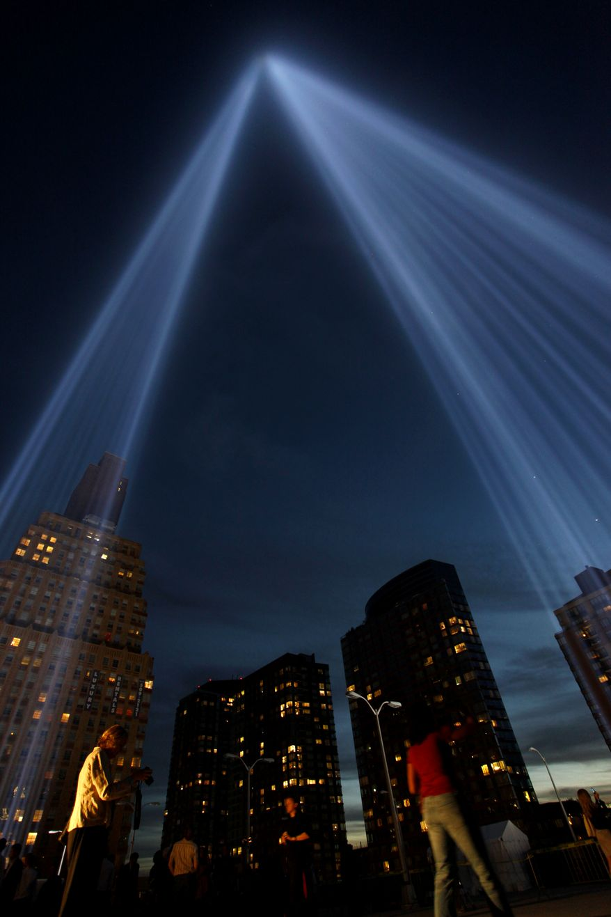 The Tribute in Lights glow skyward near the World Trade Center site, Saturday, Sept. 11, 2010 in New York. (AP Photo/Craig Ruttle)