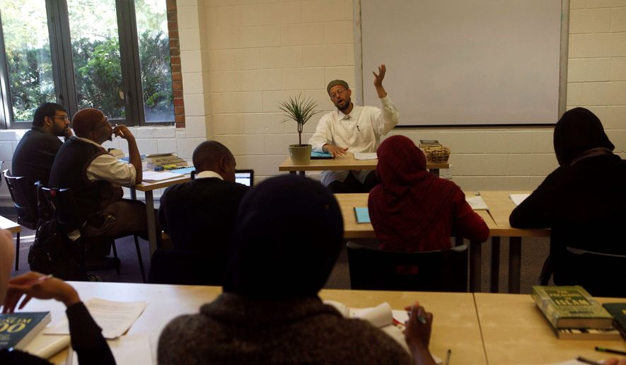 Imam Zaid Shakir lectures during Islamic history class at Zaytuna College in Berkeley. In the years to come, Zaytuna's founders hope to enroll more students, add more majors, offer graduate programs and have their own campus. The school is raising money from Muslim communities in the U.S. (Associated Press)