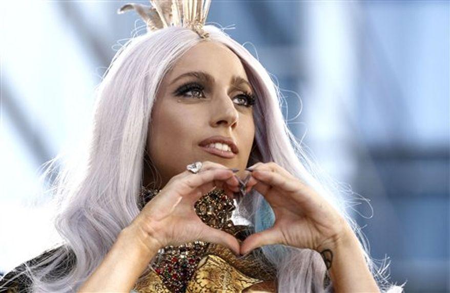 Lady Gaga arrives at the MTV Video Music Awards on Sunday, Sept. 12, 2010 in Los Angeles. (AP Photo/Matt Sayles)